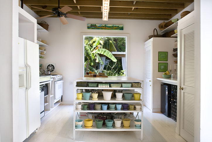 The kitchen island designed from industrial metal shelving features Meris' collection of 1940s American pottery.